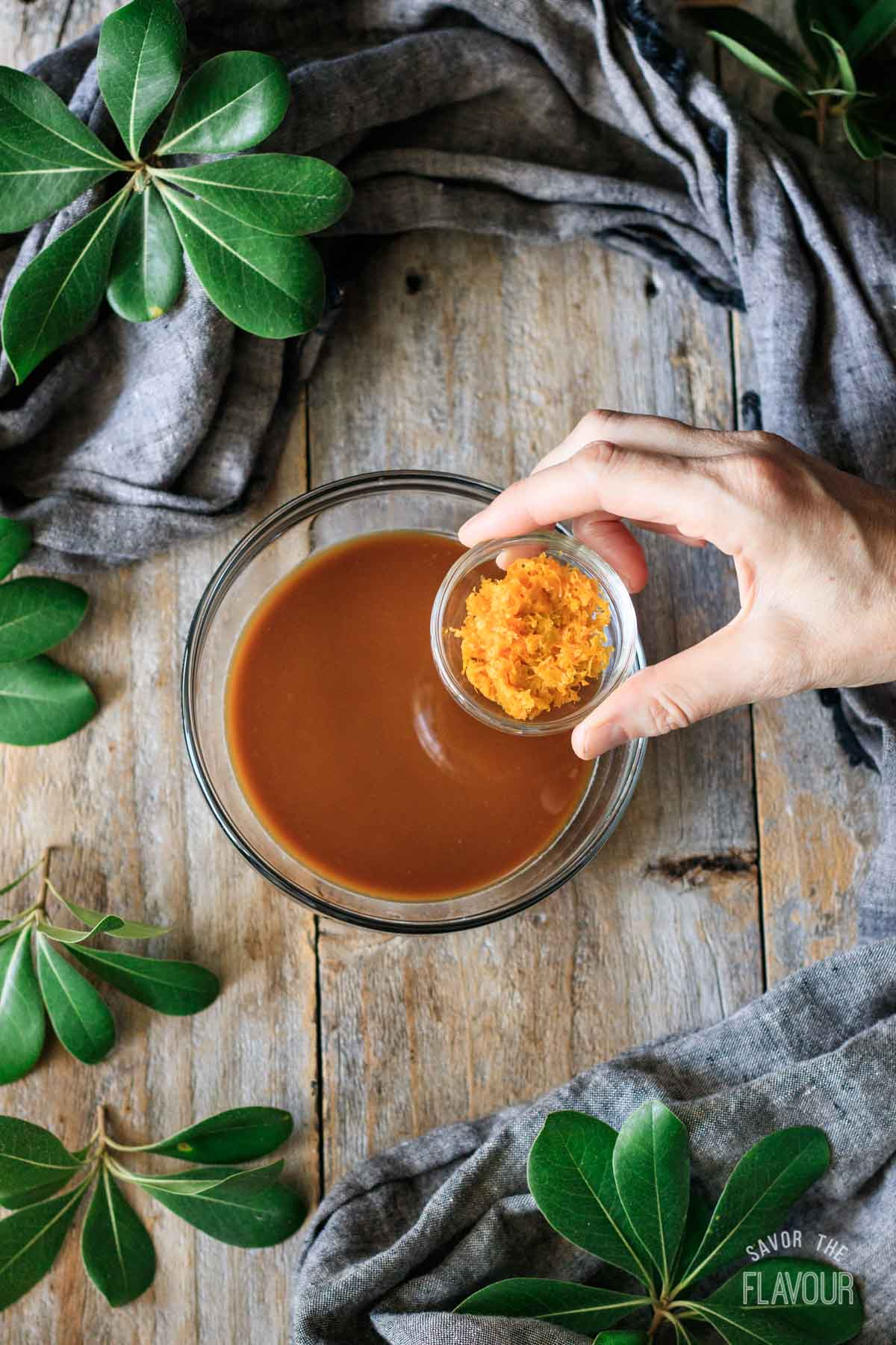 adding orange zest to the orange sauce