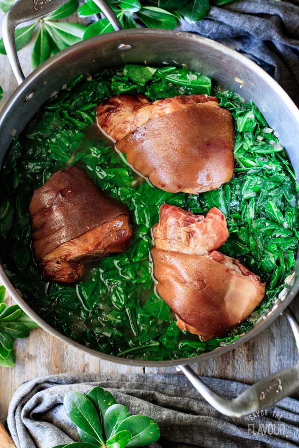 pot of cooked collard greens with ham hocks