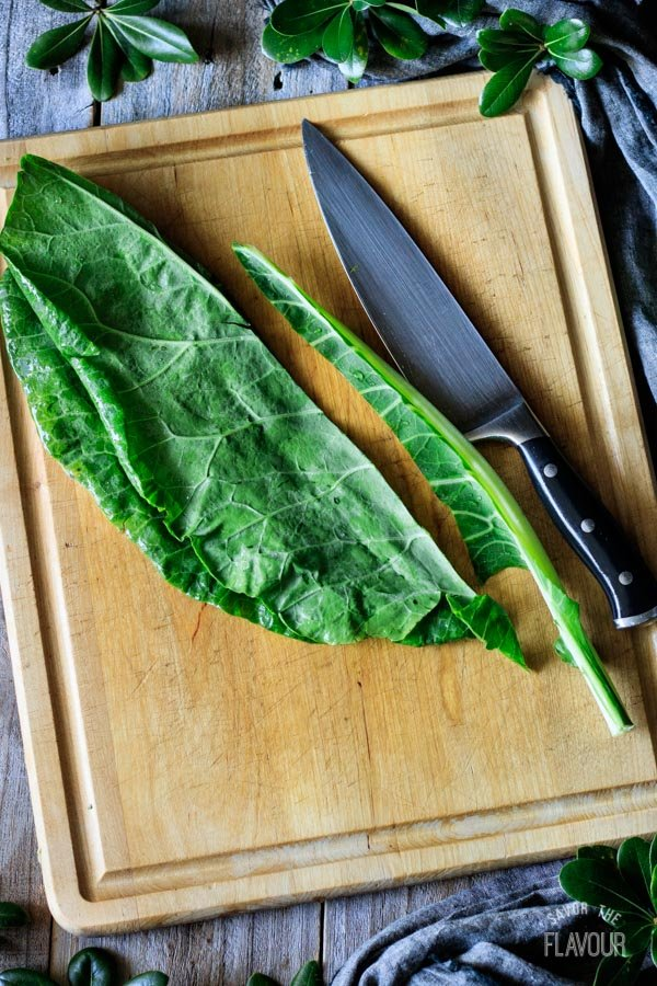 removing the rib from the collard green leaf