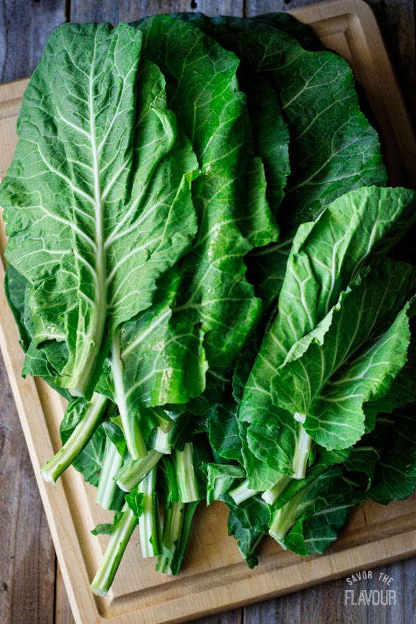 collard greens on a wooden cutting board