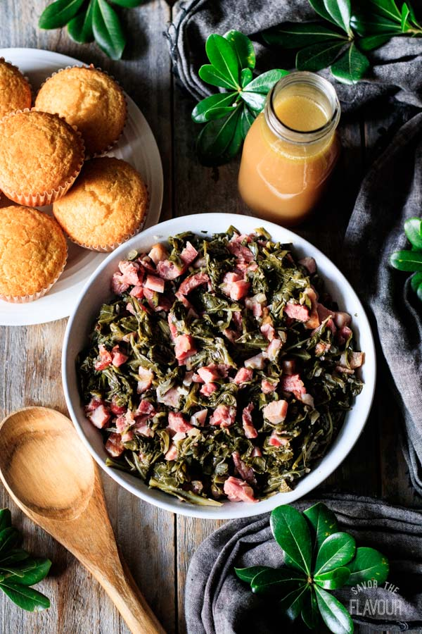 bowl of collard greens with a bottle of potlikker