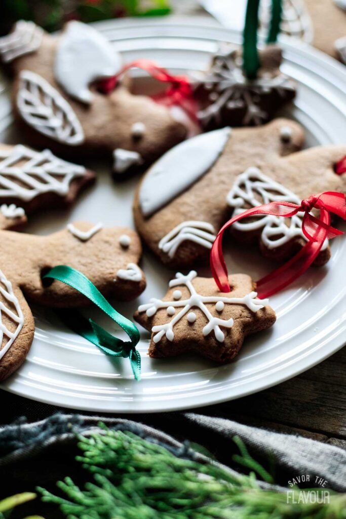 closeup of gingerbread cookie ornaments on a plate