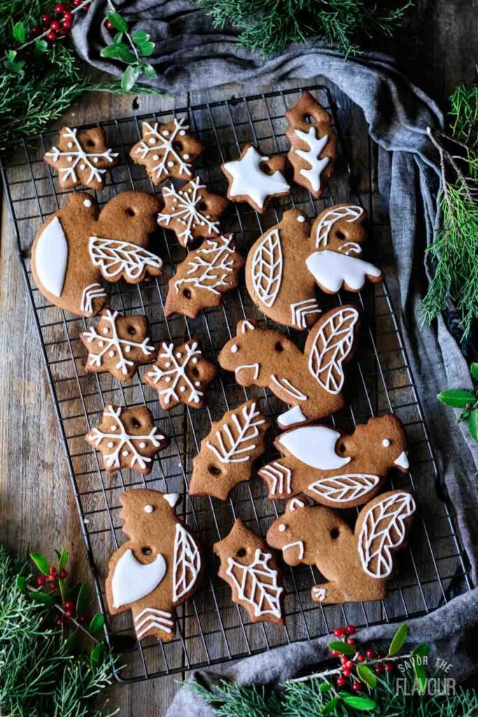 decorated gingerbread cookie ornaments on a wire rack