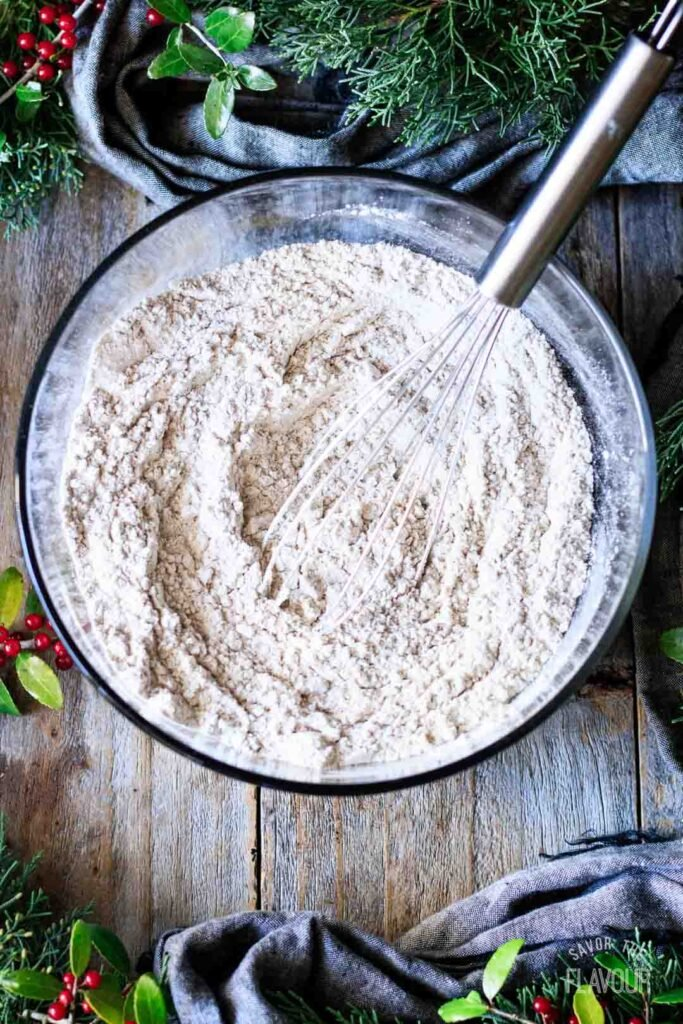 whisking a bowl of flour and spices