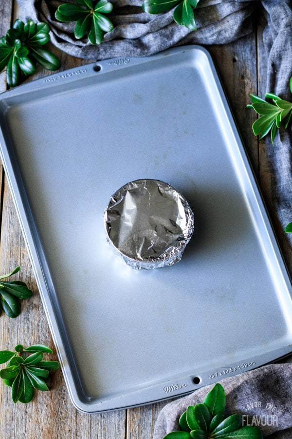 foil covered ramekin on a cookie sheet