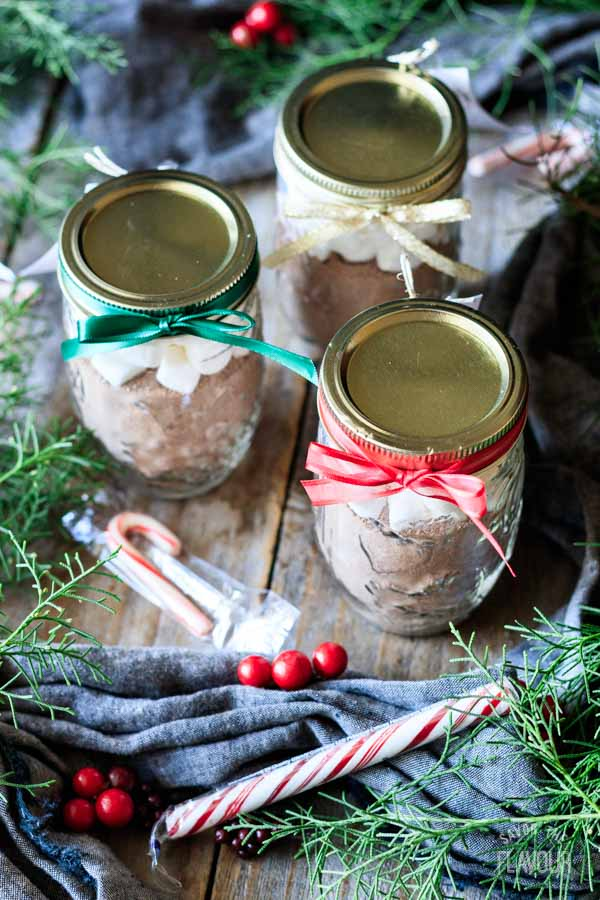 three jars of hot chocolate mix with candy canes