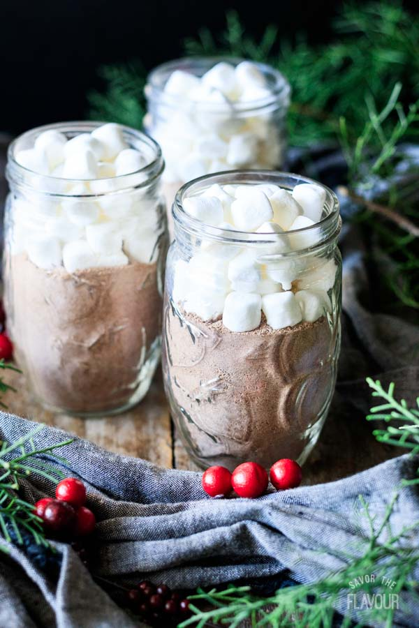 putting marshmallows in jars of hot chocolate mix
