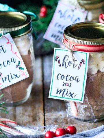 two jars of hot chocolate mix with gift tags