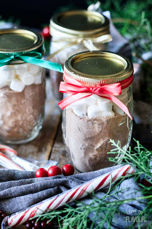 jars of hot chocolate mix with ribbons tied around the jar