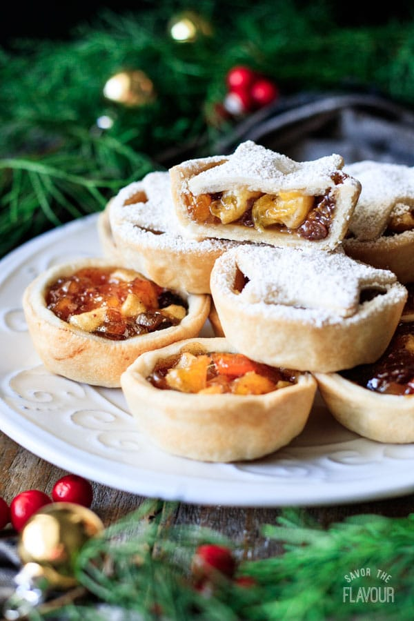 mincemeat tart cut in half with a pile of tarts