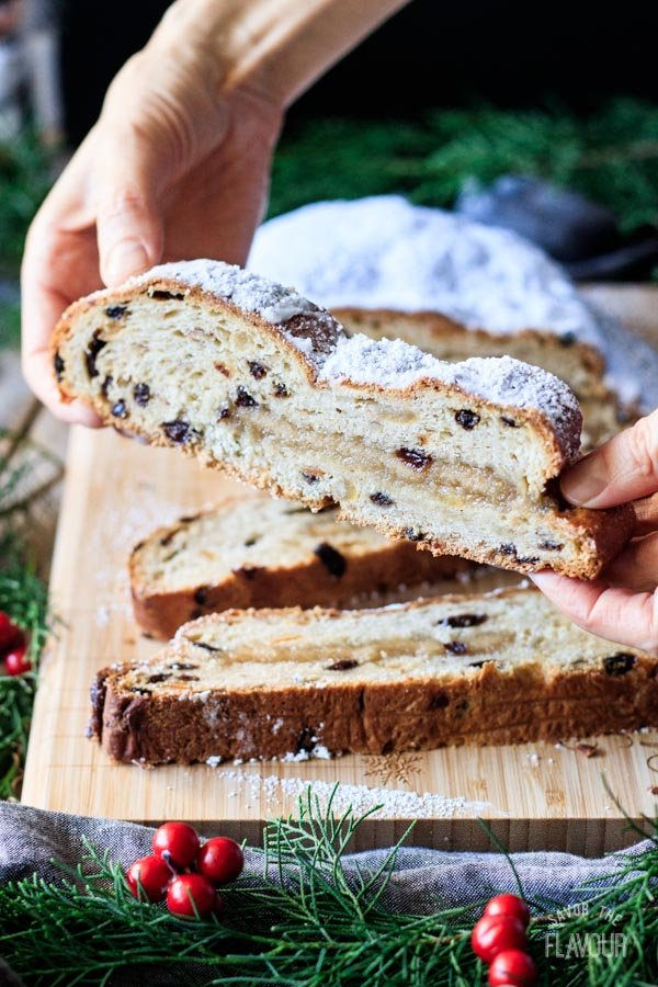 person holding a slice of German stollen
