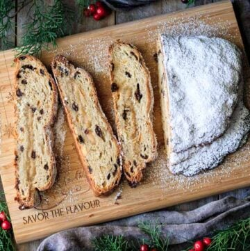 sliced loaf of German stollen on a cutting board