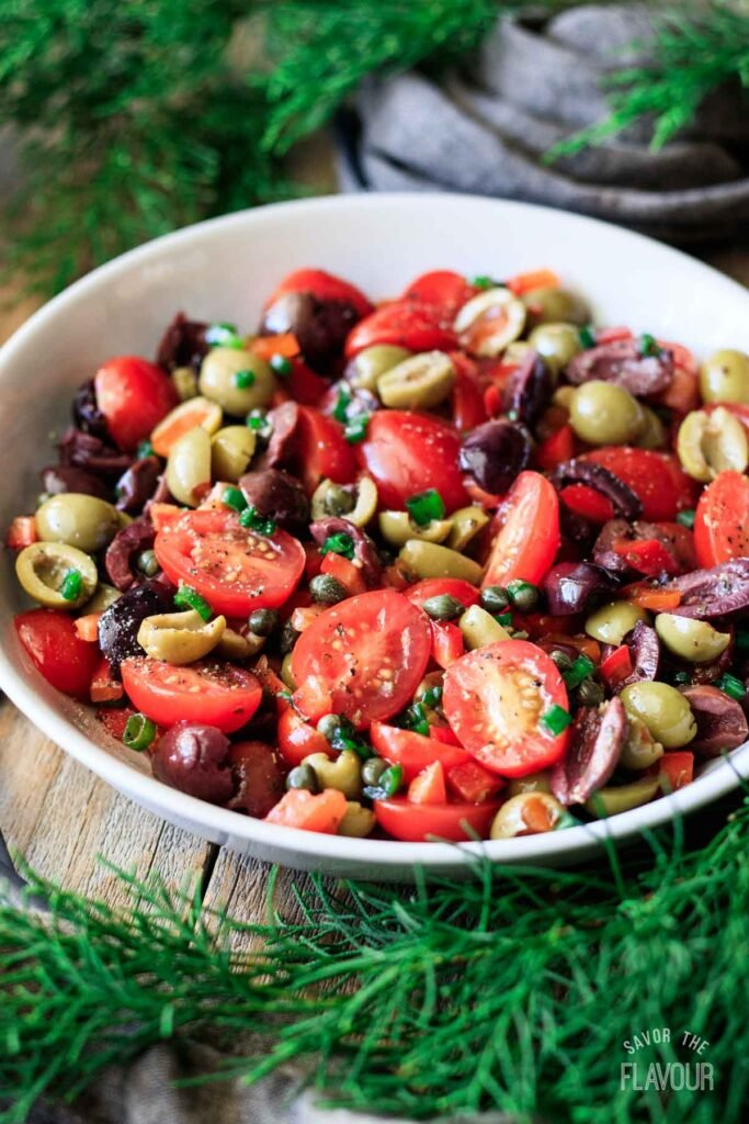 bowl of tomato olive salad