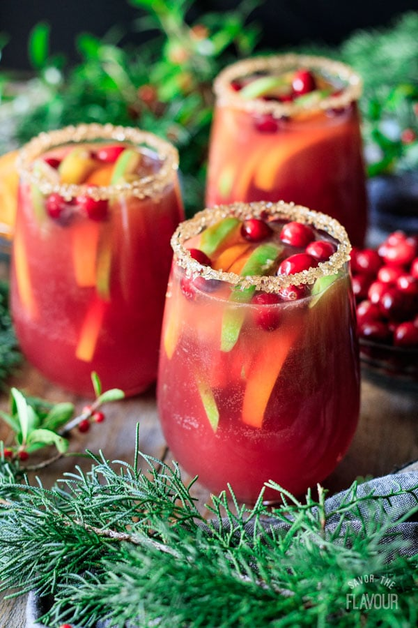 three glasses of winter sangria with cranberries