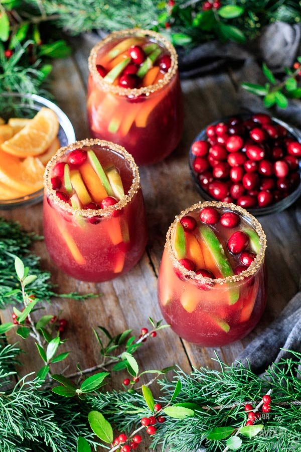 three glasses of winter sangria with fruit