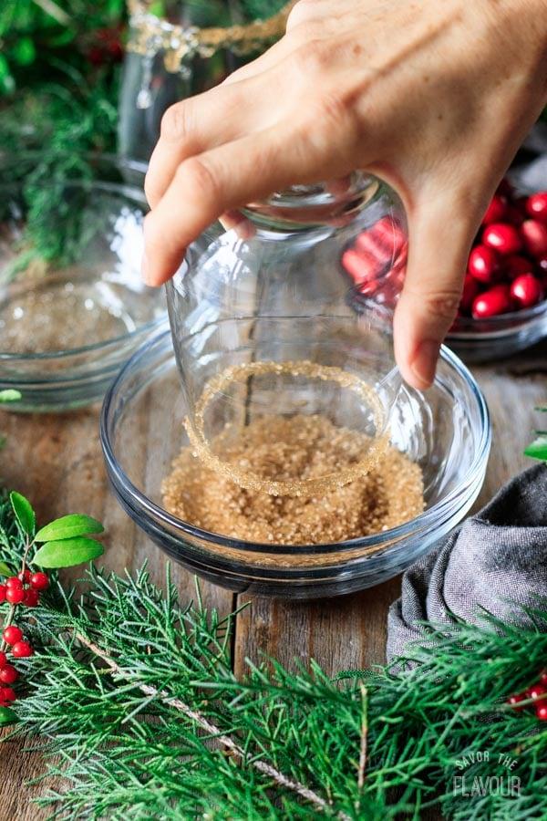 dipping rim of a glass into demerara sugar