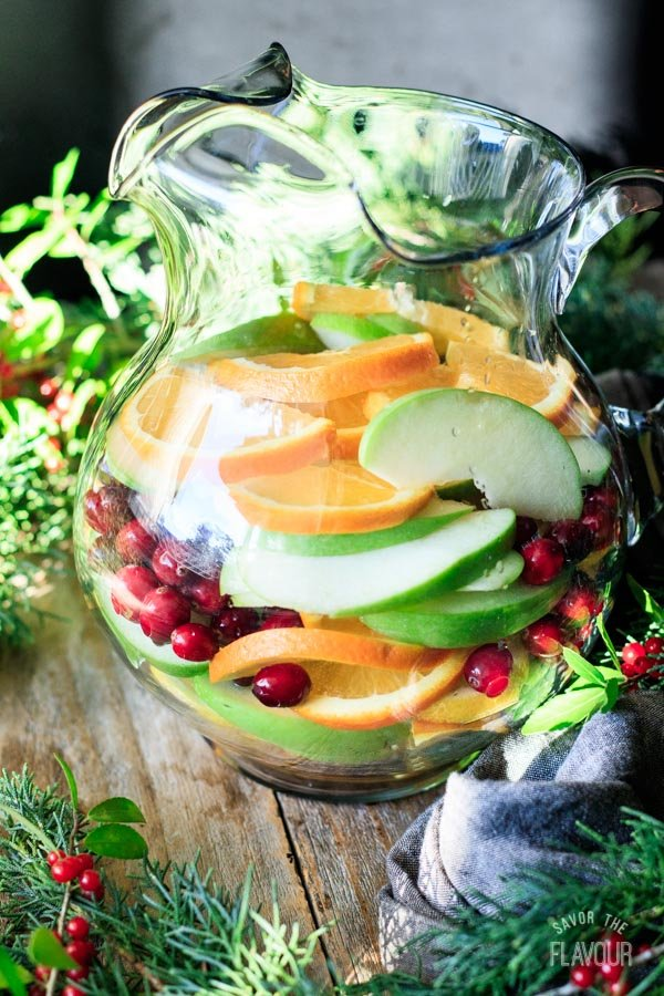 sliced fruit in a large glass pitcher