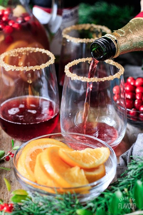 pouring sparkling grape juice into a glass