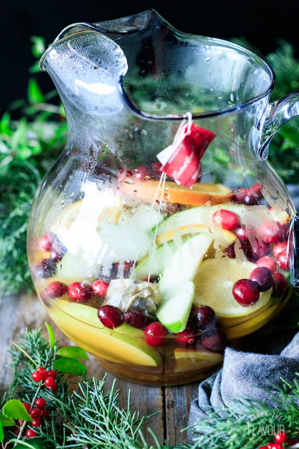 steeping the tea with the sliced fruit