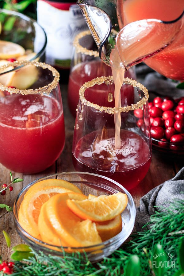 pouring winter sangria into glasses