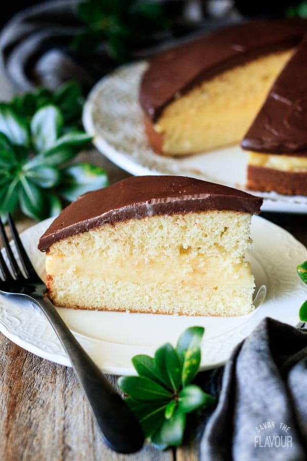 slice of Boston cream pie with a fork