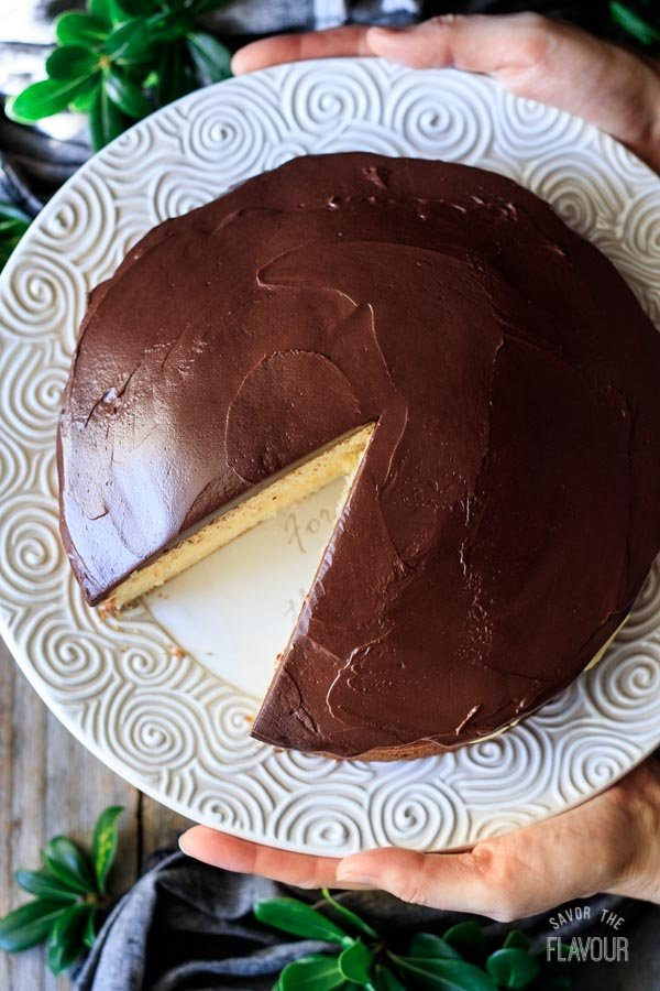 person holding a Boston cream pie