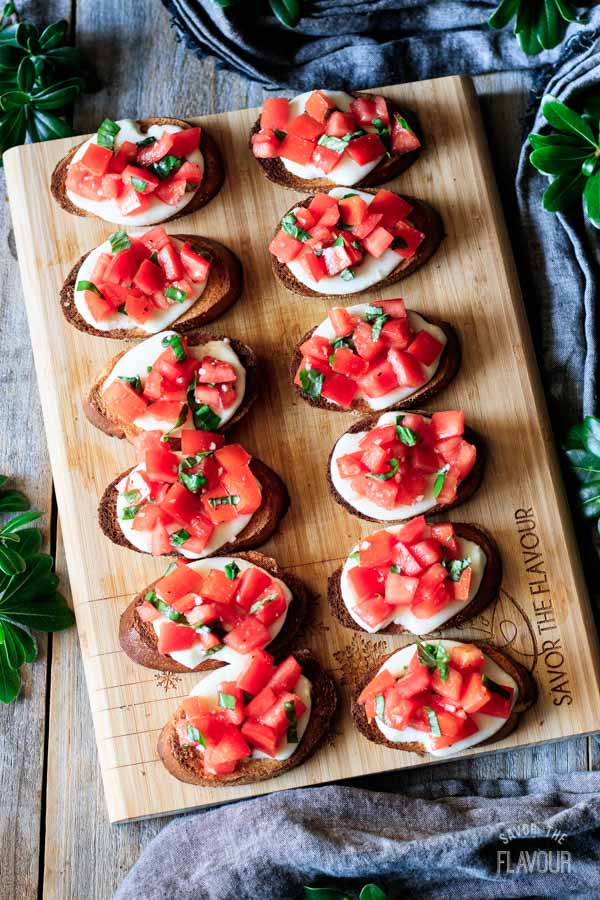 Caprese bruschetta on a cutting board