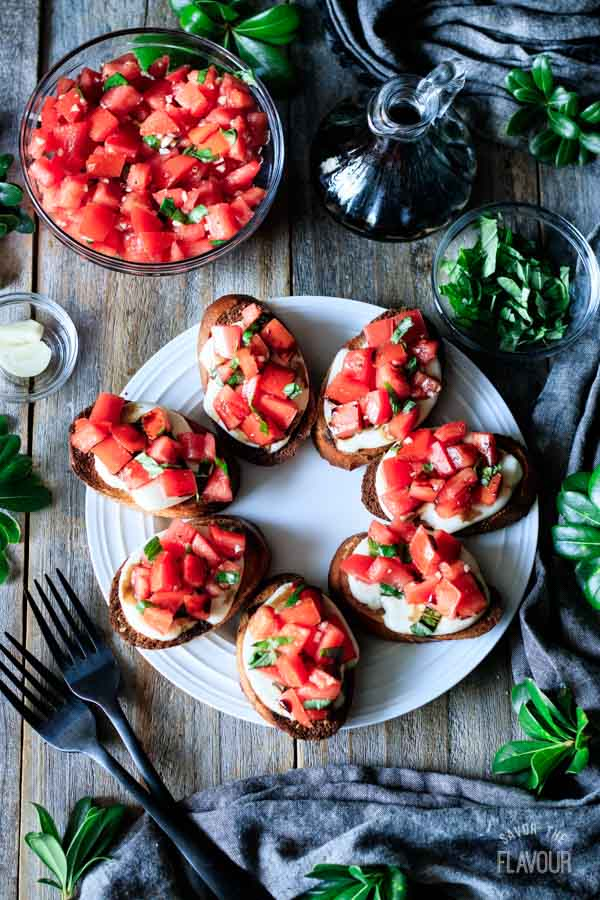 plate of Caprese bruschetta with tomato salad