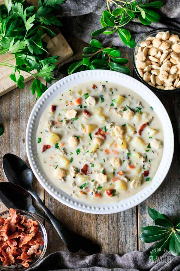 bowl of clam chowder with two spoons