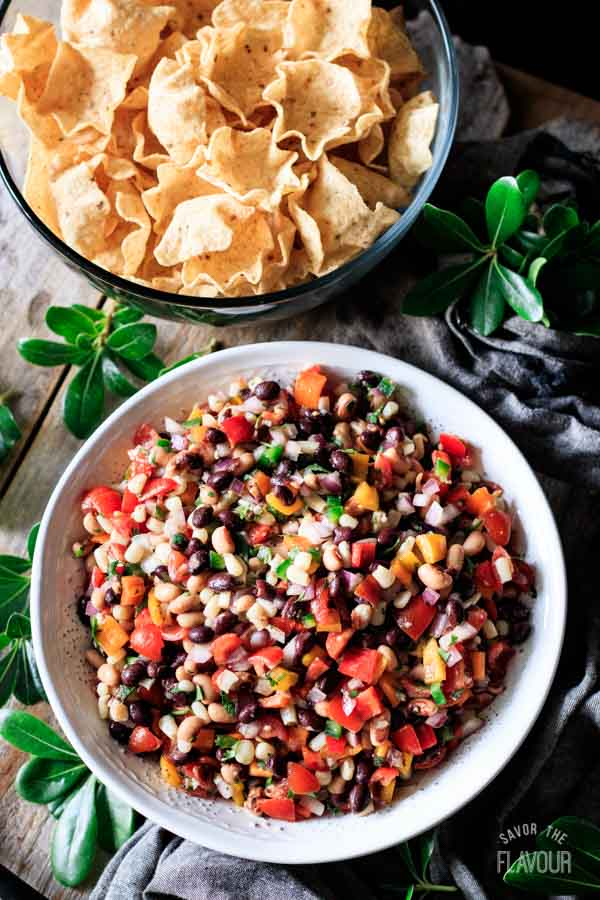 top down view of a bowl of cowboy caviar with chips