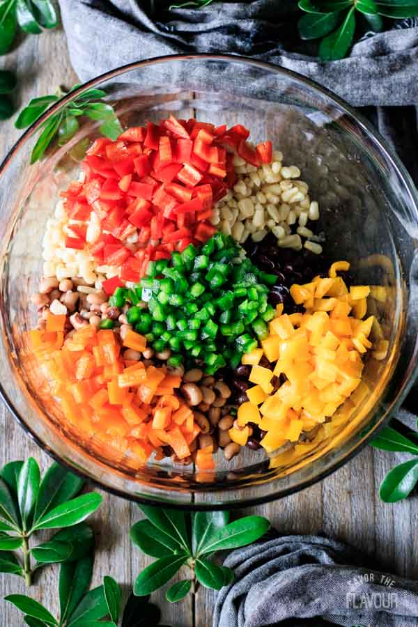 peppers, corn, and beans in a bowl