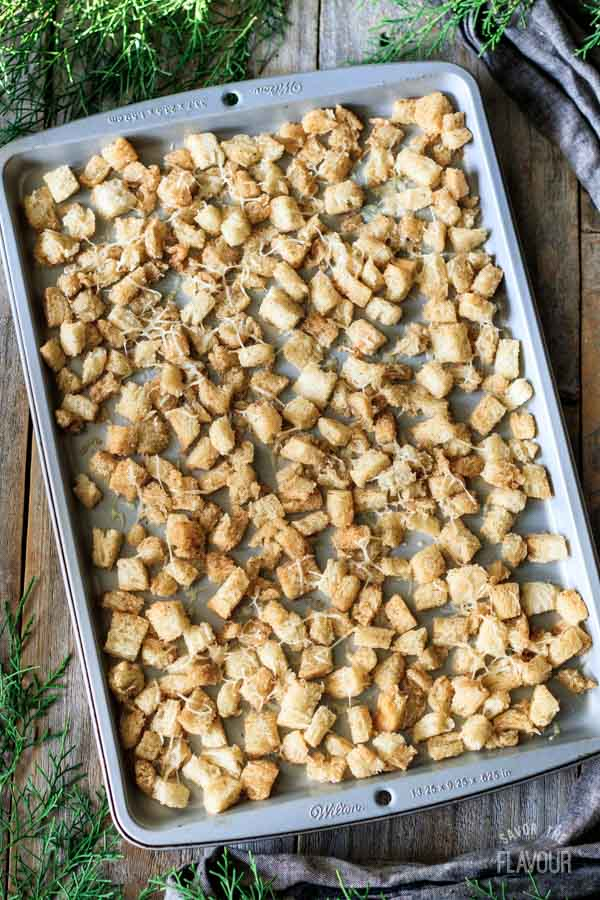 baked croutons on a cookie sheet