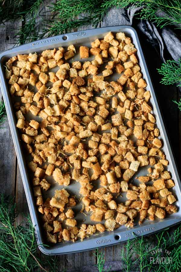 fully baked croutons on a cookie sheet