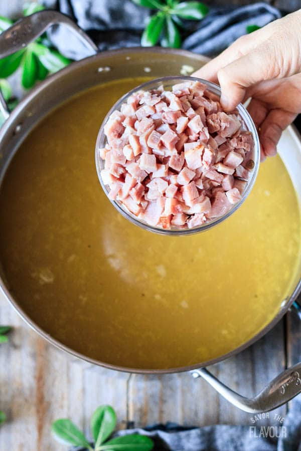 adding cubed ham to the soup