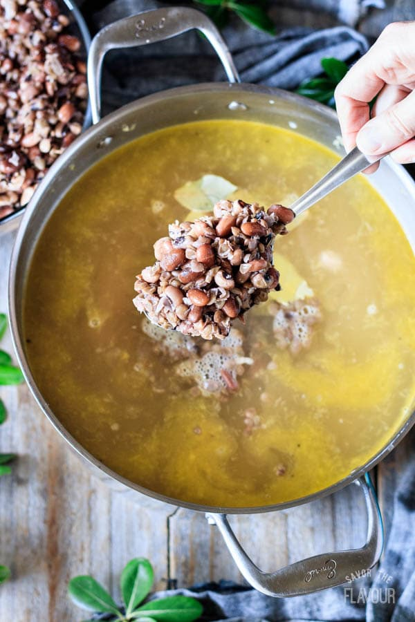 adding the soaked dried beans to the soup
