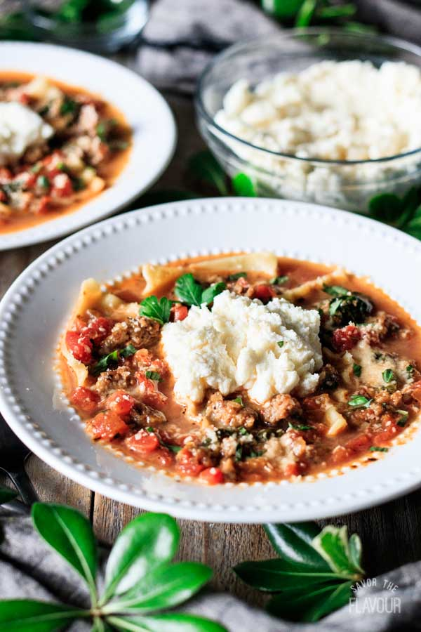 bowl of lasagna soup with a bowl of cheese