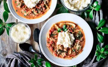 two bowls of lasagna soup with two spoons