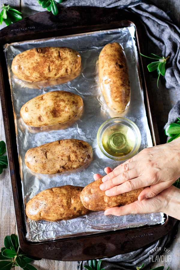 rubbing potatoes with oil