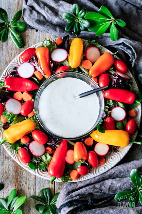 plate of veggies with a bowl of buttermilk ranch dressing