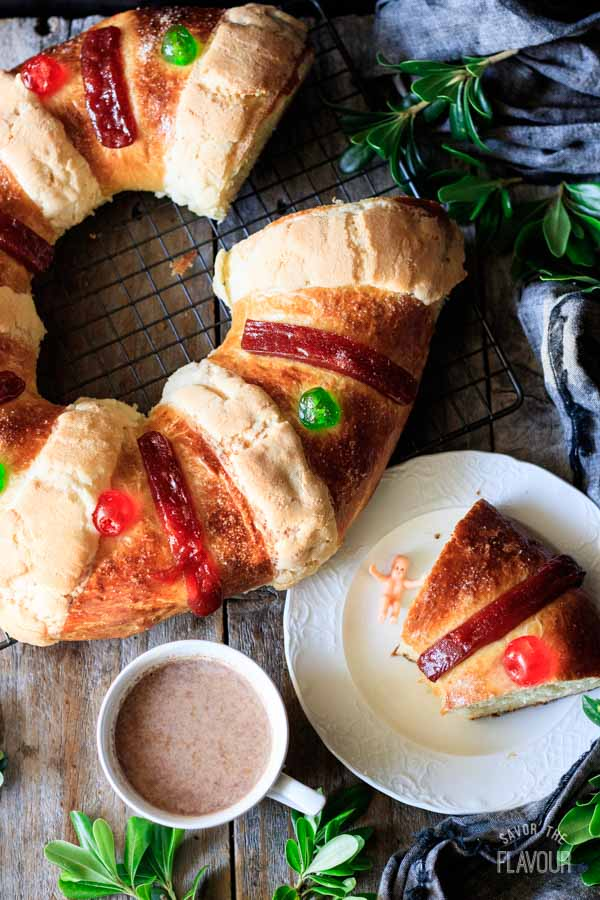 slice of Rosca de Reyes with a cup of hot chocolate