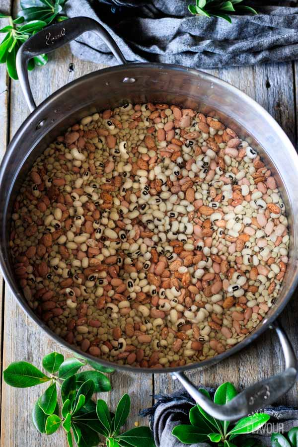 dried beans in a pot of water