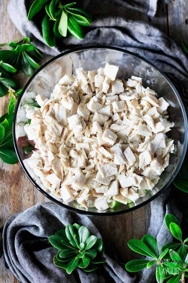 adding chopped turkey to salad