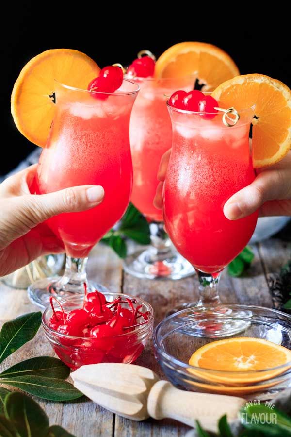 people doing a toast with two hurricane mocktails