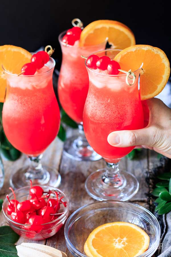 person holding a hurricane mocktail