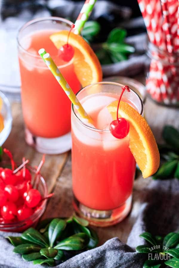 two Shirley Temple drinks with paper straws