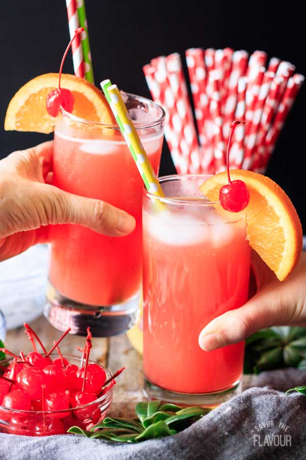 two people doing a toast with Shirley Temple drinks
