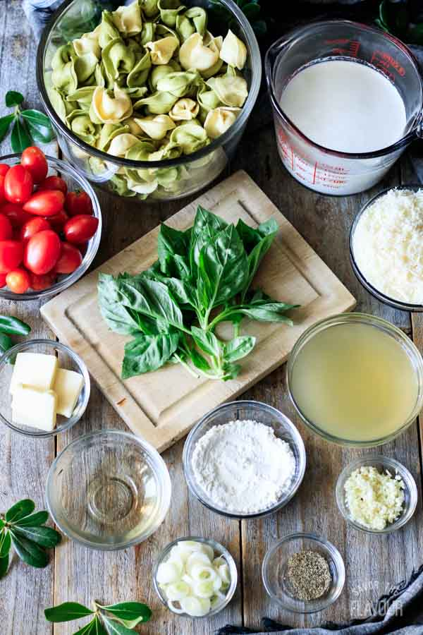 bowls of ingredients for alfredo basil sauce