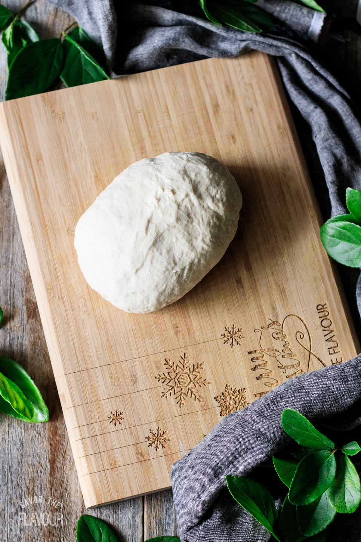 kneaded dough on a cutting board