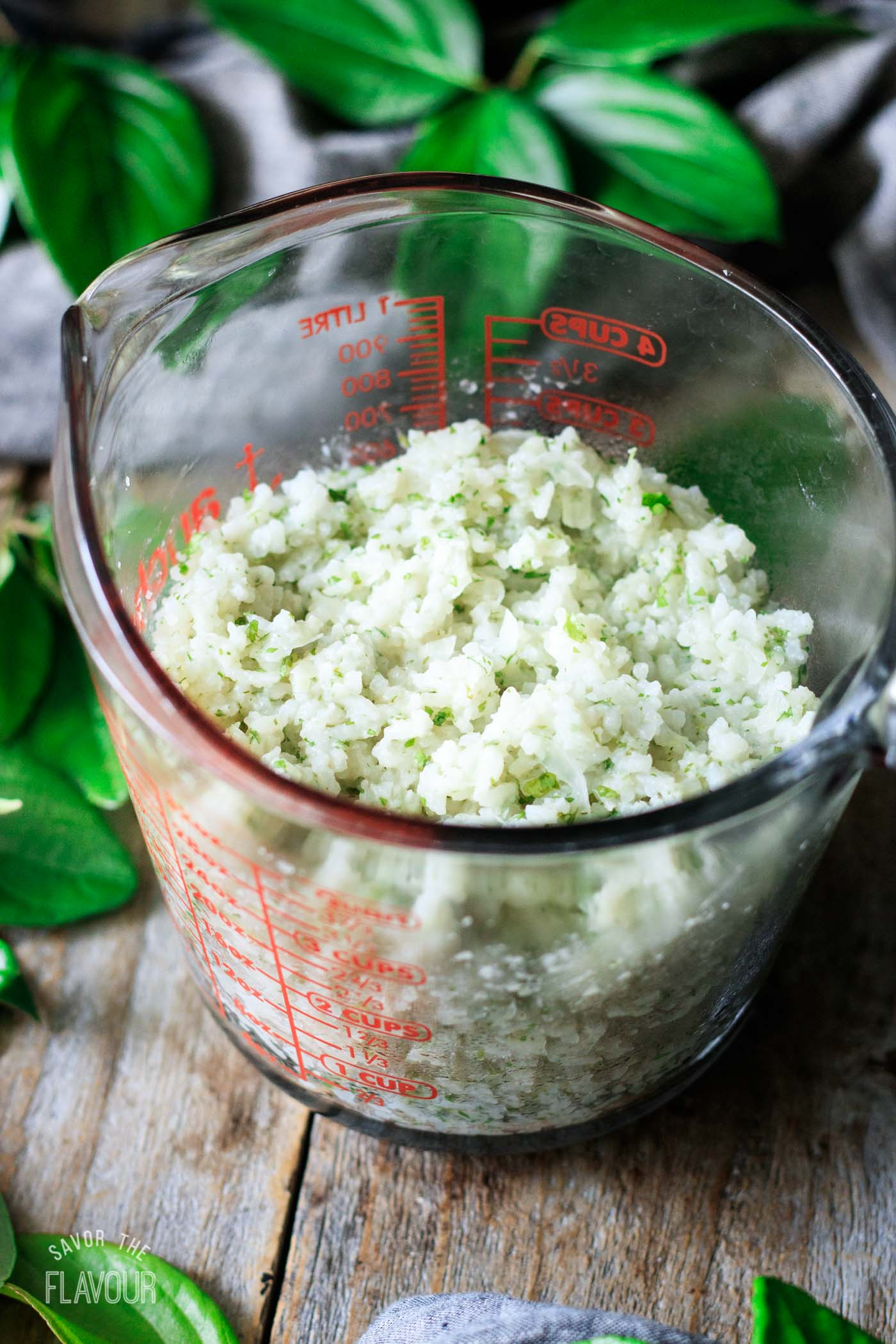 cilantro lime rice in a glass measuring cup