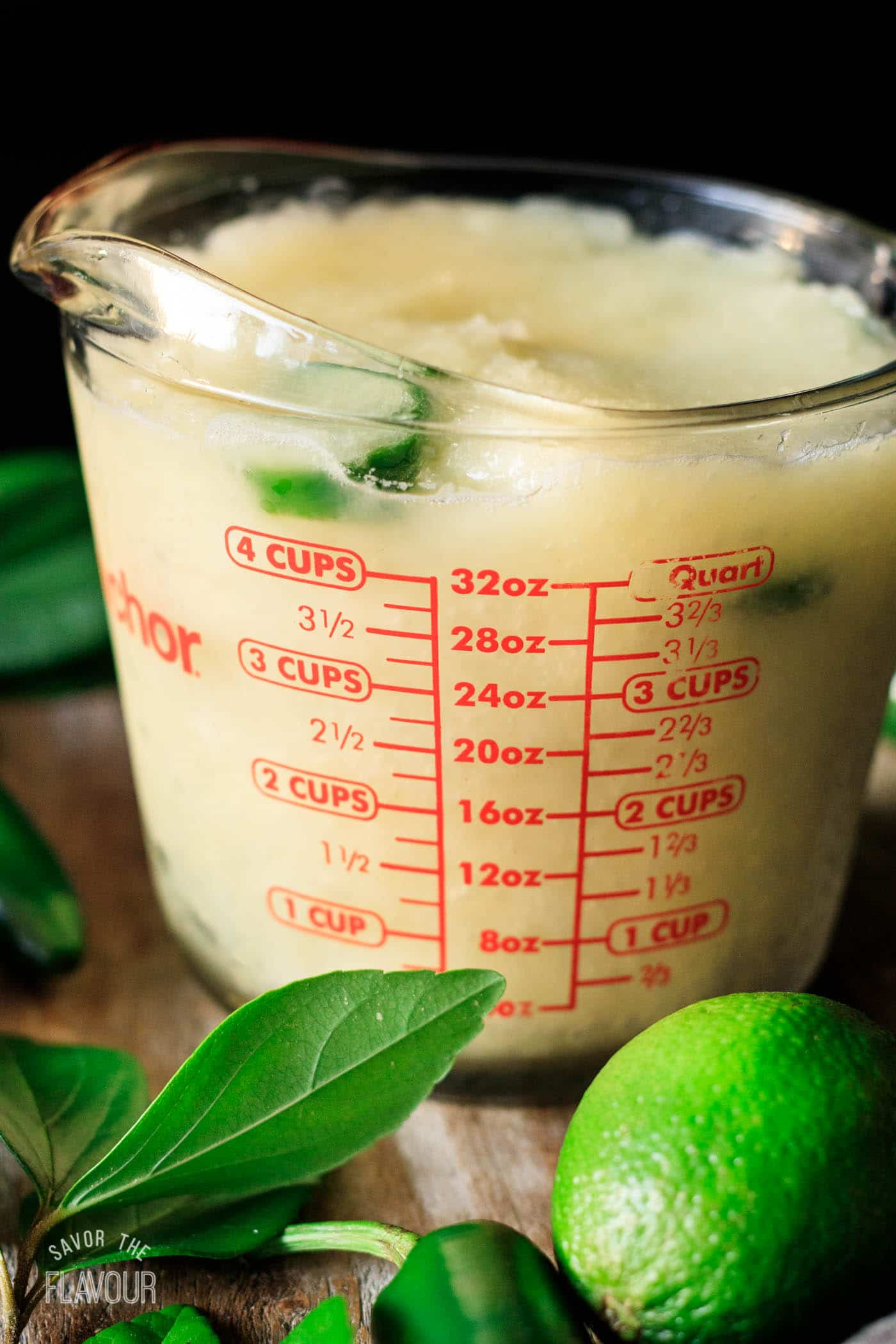 frozen jalapeño margarita mixture in a measuring cup